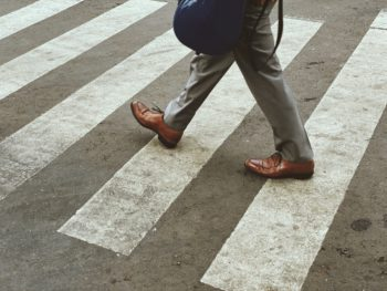 man crossing crosswalk